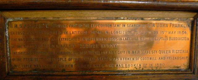 Brass Plaque on the Writing Table